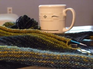 Still life of tea and knitting