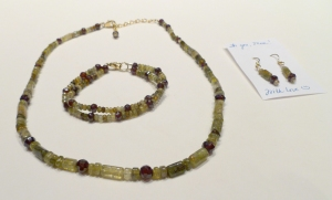 Red and green garnet necklace, bracelet, and earrings